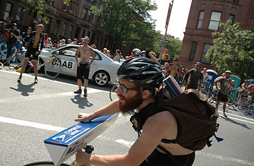 Bike messenger Dwain Walters, 21, competes in a relay race for bike messengers at this year's Harlem Rocks 35th Annual Skyscraper Cycling Classic in Marcus Garvey Park.