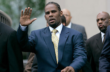 Teary R. Kelly waves to fans as he exits courts