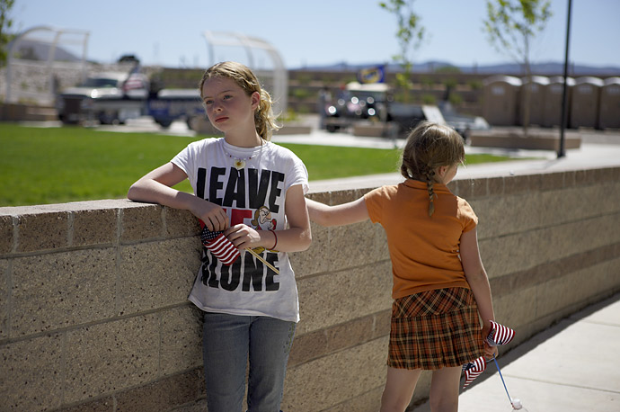 Two girls wait as Republican presidential candidate, Senator John McCain makes a campaign stop in Albuquerque, New Mexico.