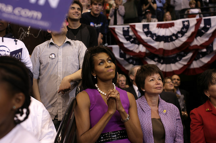 Michelle Obama listens to her husband deliver his victory speech for the Democratic nomination at Excel Arena in St. Paul, Minnesota.
