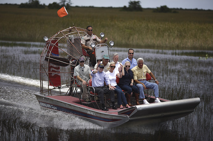 John McCain, wife Cindy McCain, daughter Meghan McCain, Florida Gov. Charlie Crist ride on an airboat as they tour the Everglades Safari Park in Miami, Florida.