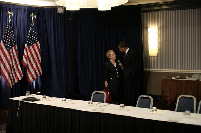 Barack Obama talks with former Secretary of State Madeleine Albright after a series of meetings at a Foreign Policy Summit in Washington, DC.