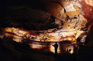 Paleolithic bulls and other animals crowd calcite walls at Lascaux. The paintings were done by prehistoric artists over 17,000 years ago.
