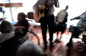 A music therapy session for Alzheimer's patients being held at a geriatric hospital near Lyon, France, in February 2008