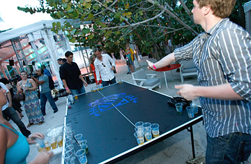 Guests play beer pong at the official kickoff party for Mercedes-Benz Fashion Week Swim at the Raleigh Hotel on July 17, 2008 in Miami, Florida.