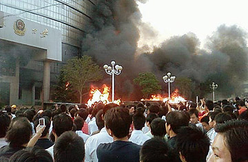 Flames raise in front of a police building in Weng'an China on Saturday, June 28, 2008. Thousands of protesters furious over how officials handled a teenage student's death set fire to police and government buildings and overturned vehicles