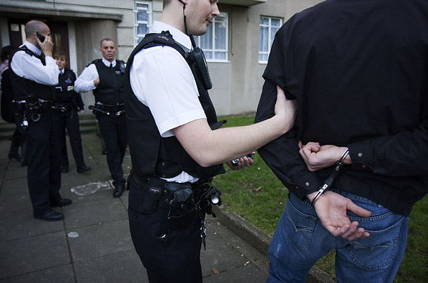 Police working in rapid response units wear anti-stab jackets and carry handcuffs and batons
