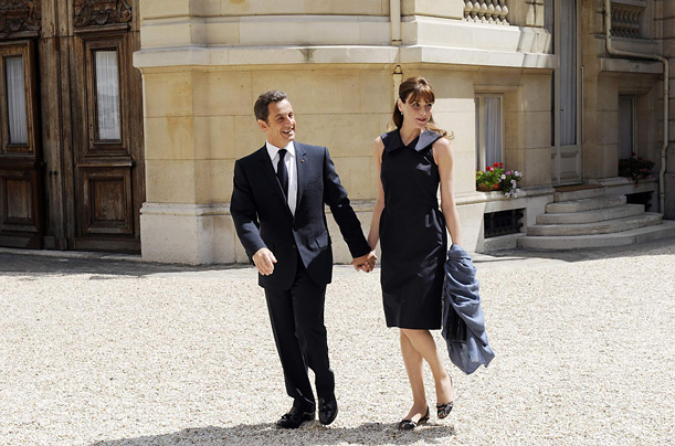 France's President Nicolas Sarkozy and his wife Carla Bruni-Sarkozy arrive at the Hotel Marigny July 14, 2008 in Paris, to attend the traditional garden party