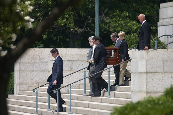The urn containing the remains of former White House Press Secretary Tony Snow is carried from the Basillica of the National Shrine of the Immaculate Conception in Washington.