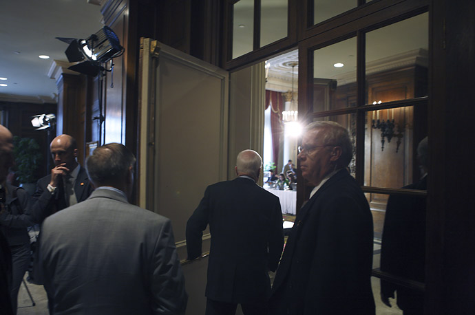 John McCain walks in to a news conference after delivering a speech to the Economic Club of Canada in Ottawa.