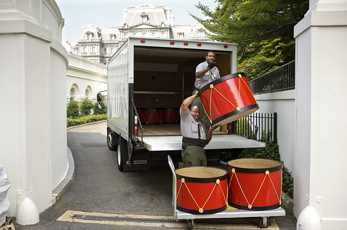 National Park Service workers move decorative stands at the White House.