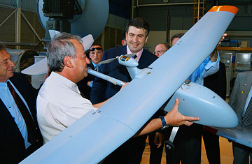 Georgian President Mikheil Saakashvili is shown an Israeli Aircraft Industries pilotless drone during his visit  to their factories at Lod, Israel.