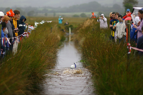 Competitors race along two lengths of a 60 yard trench cut through the peat bog, wearing snorkels and flippers