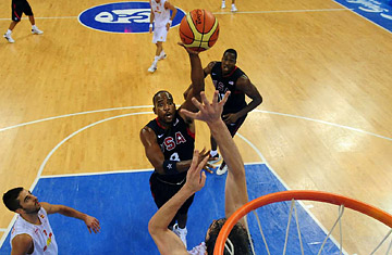 Team USA's Dwyane Wade takes a shot during a preliminary match agaisnt Spain.