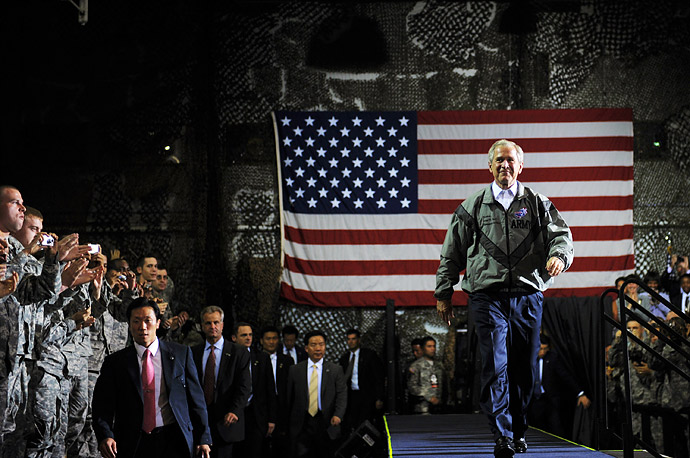 President Bush makes his way to the podium to address troops at the US Army Garrison in Seoul, Korea on the first leg of his Asian tour.