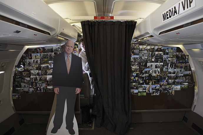 A cardboard cut-out of the candidate rests aboard John McCain's plane, flying from California to Florida.