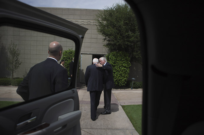 Senator McCain and his personal aide Brooke Buchanan  travel to a fundraiser in Phoenix, Arizona.