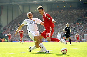 Manchester United's Wes Brown and Albert Riera of Liverpool in action  AIG