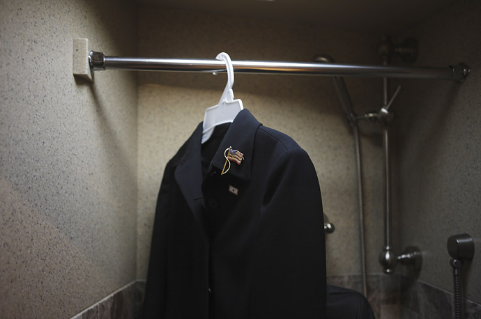 The dress worn by Sarah Palin at the announcement of her candidacy hangs in the shower on the campaign bus.