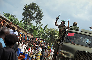 Rebel fighters from the National Congress for People's Defense (CNDP), under the direction of renegade General Laurent Nkunda, parade in Rumangabo, north of the Eastern Congolese town of Goma violence