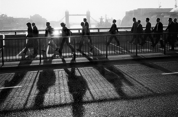 Traders and business workers make the morning trudge across London Bridge