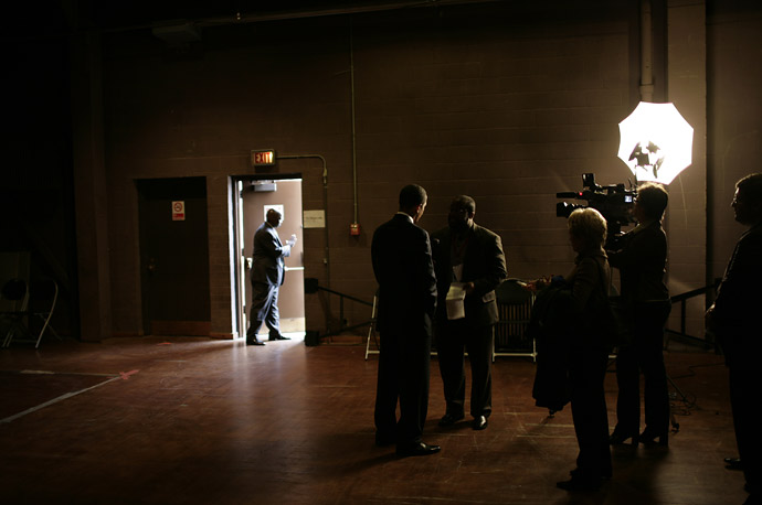 Senator Barack Obama gives a television interview backstage after a rally at the Civic Center in Canton, OH.