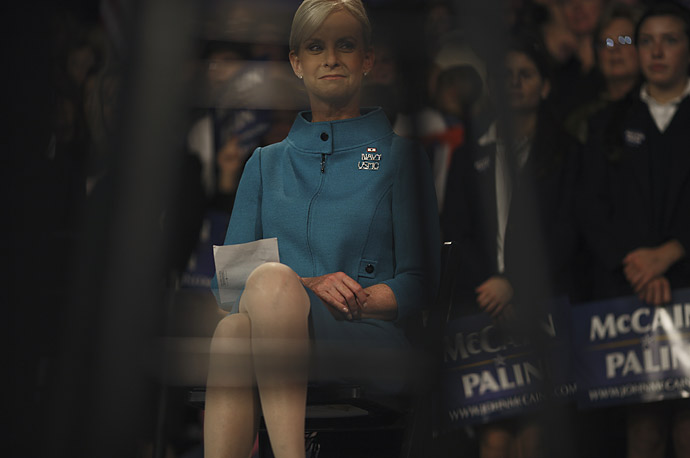 Cndy McCain listens to her husband, Republican presidential candidate Senator John McCain, at a campaign rally at Montgomery County Community College October 14, 2008 in Blue Bell, Pennsylvania.