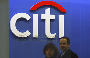 Employees walk through the Citigroup headquarters in New York, November 24, 2008.