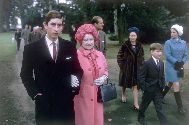 Prince Charles arm in arm with his grandmother, Queen Elizabeth, the Queen Mother