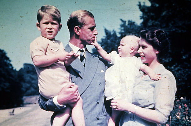 Images of Windsor family life — Prince Philip holds Charles, while the Queen cuddles her daughter Anne