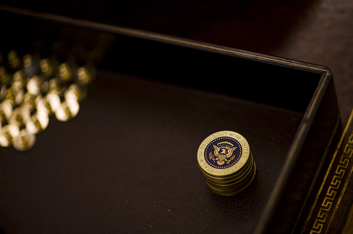 Presidential coins and pins on the desk of President Bush in the Oval Office at the White House.