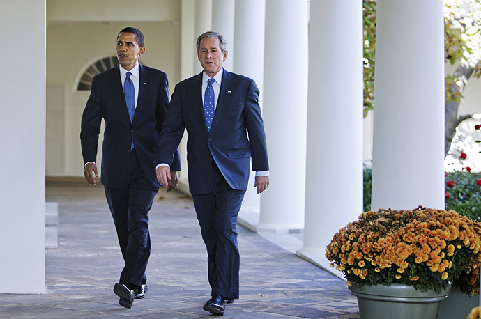 President Bush walks with President-elect Barack Obama down the Colonnade of the White House in Washington, Monday, Nov. 10, 2008, to the Oval Office.