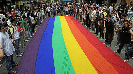 Gay-rights activists form a human chain around a rainbow flag in Hong Kong