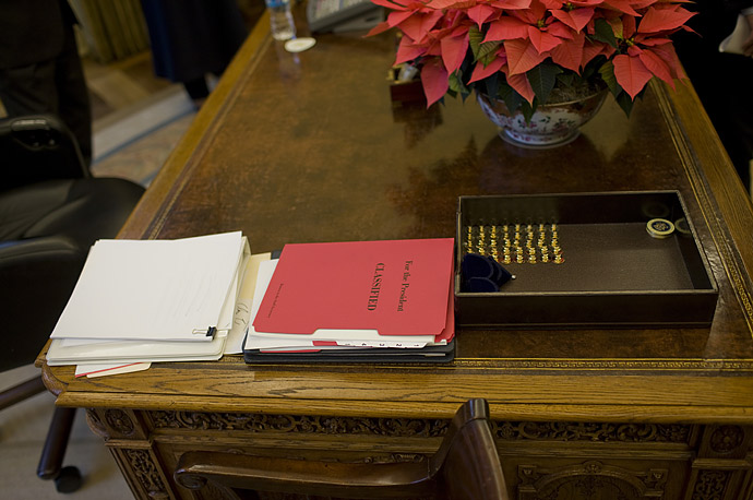 A classified documents folder on the desk of U.S. President George W. Bush in the Oval Office at the White House in Washington.
