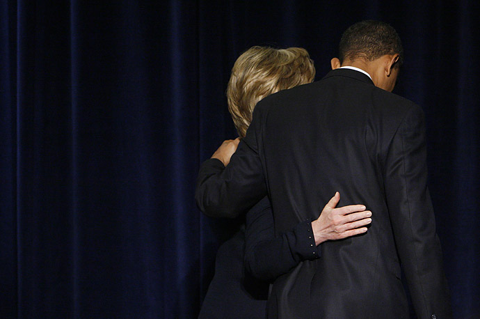 President-elect Barack Obama and Secretary of State-designate Sen. Hillary Rodham Clinton walk out together after a news conference in Chicago.