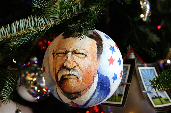An ornament featuring former President Theodore Roosevelt hangs on the official White House Christmas tree in the Blue Room.