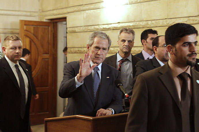 President Bush reacts after a man threw two shoes at him during a news conference with Iraqi Prime Minister Nouri al-Maliki in Baghdad.