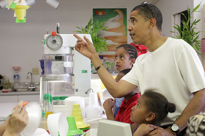 President-elect Barack Obama points out different flavors of shave ice to youngest daughter Sasha (R) as his oldest daughter Malia looks on (L) at Kokonuts Shave Ice and Snacks at Koko Head Marina shopping mall on December 26, 2008 in Honolulu, Hawaii.