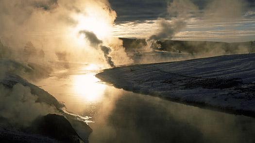 The Firehole River in Yellowstone National Park flows past other geysers, including  Old Faithful, part of the Yellowstone Caldera
