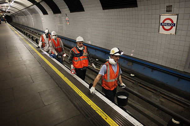At Pimlico, cleaning staff prepare to leave a station to clean a tunnel