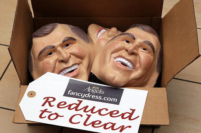 George W. Bush face masks are reduced to make way for new stock of Barack Obama masks at a store in London.