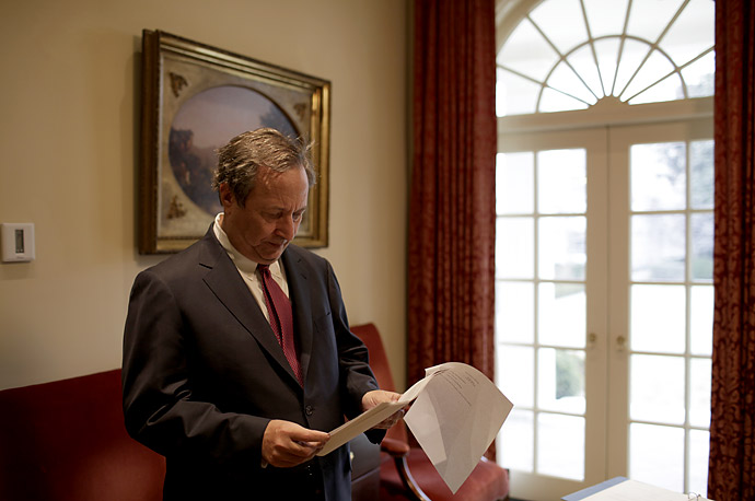 Larry Summers waits outside the Oval Office to give his daily budget briefing to President Obama.