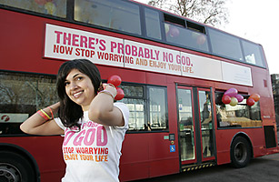 Ariane Sherine in front of a London bus featuring the atheist advertisement with the slogan