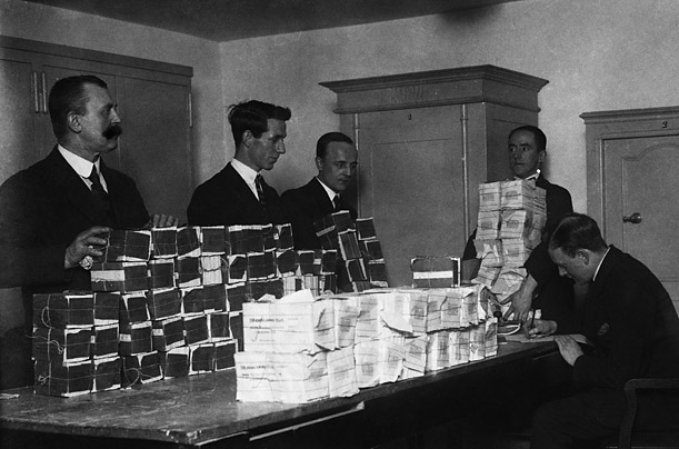 Millions of marks are stacked and counted in a Cologne bank