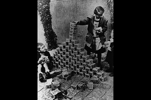 German children playing in the streets with worthless money