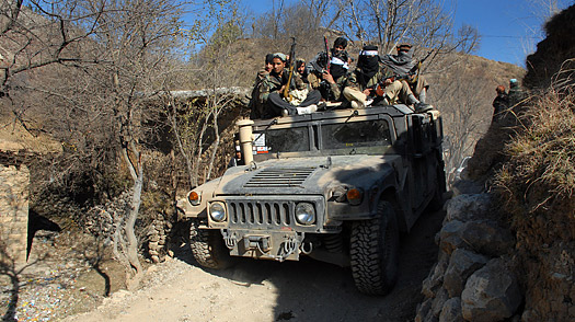 Taliban militants patrol on a humvee during a patrol in the Mamouzai area near the border.