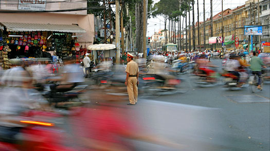 A police officer directs rush-hour traffic in Saigon, Vietnam