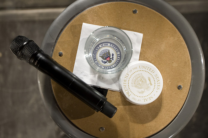 U.S. President Barack Obama's water glass and microphone at a town hall meeting in Costa Mesa, California.