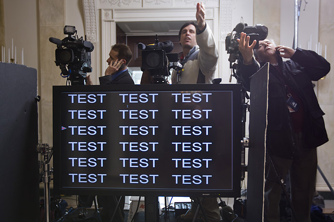 Technicians set up the teleprompter in the Grand Foyer of the White House for President Obama's speech.