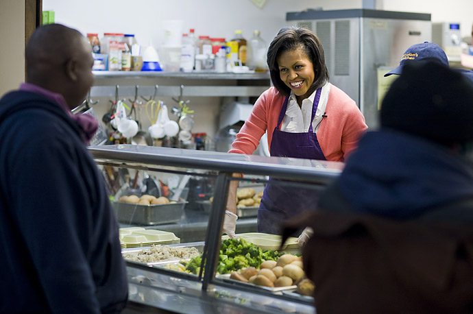 First lady Michelle Obama serves meals at Miriam's kitchen, a center that provides meals, case management services and housing support to the homeless, in Washington, DC.